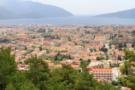 Marmaris, Turkey. Urban density. High view, static shot. View across Marmaris City to port. Turunc resort in the distance Фото со стока