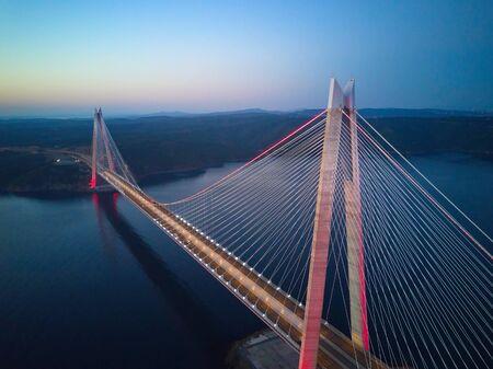 Aerial of Yavuz Sultan Selim Bridge, Istanbul. Empty streets amid coronavirus total lockdown in the Mega City. One of the longest railroad suspension bridges. Bridge towers are 3 30m high