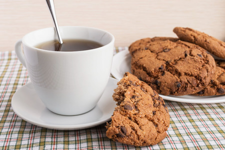 americano: Cup of tea and cookies with chocolate Americano on a light background
