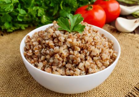 dietary: Buckwheat porridge in white bowl. Dietary dish. Vegan.