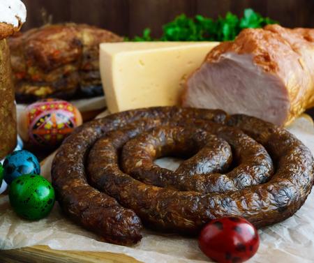 english cucumber: Juicy pork sausage. Easter dishes. Stock Photo