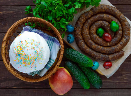 english cucumber: Juicy pork sausage. Easter dishes. The top view