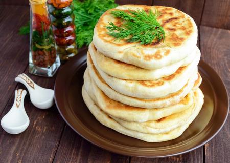 georgian: Traditional Georgian cheese pie - khachapuri. The national cuisine of Georgia. Stock Photo