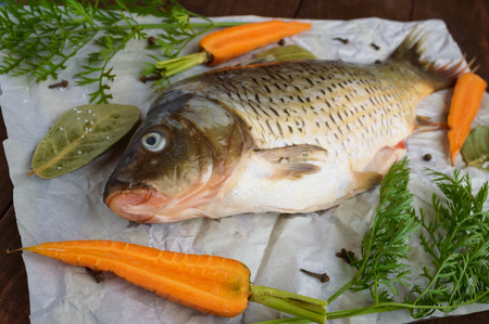 river fish: River fish - bream with spices on a wooden background. Stock Photo
