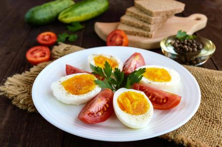 light diet: Boiled egg and fresh tomato, black bread - light diet breakfast.