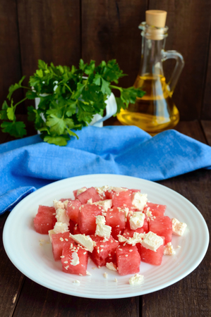 light diet: Light diet summer salad of fresh watermelon and feta cheese with sesame seeds.