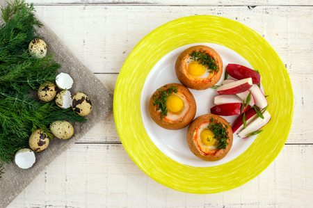 flavorful: Baked small flavorful bun with bacon, cheese, quail egg and greens. Tasty breakfast. The top view