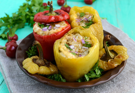 Yellow and red baked peppers stuffed with minced meat and rice.