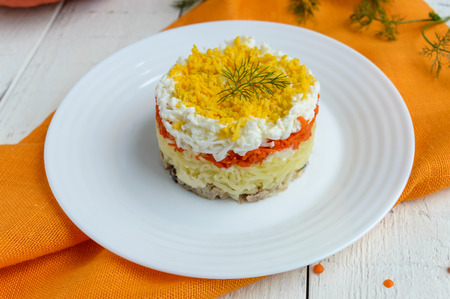 slavonic: Easy Diet salad layers in the shape of a circle (tuna in oil, boiled potatoes, carrots, eggs). Alternative Slavonic traditional dish Mimosa.