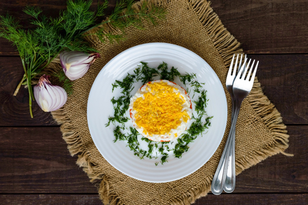 slavonic: Easy Diet salad layers in the shape of a circle (tuna in oil, boiled potatoes, carrots, eggs). Alternative Slavonic traditional dish Mimosa. The top view