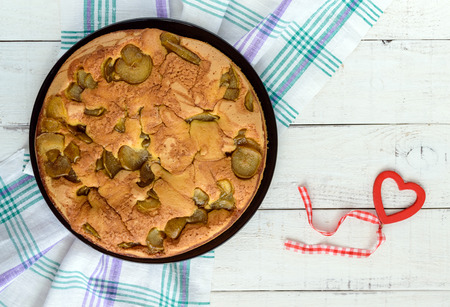 home baked: Home baked biscuit flavored pear charlotte cake with cinnamon. On a white wooden background. The top view.