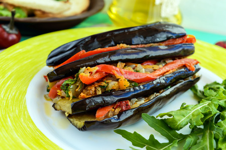 satisfying: Baked eggplant slices stuffed with vegetables. Satisfying vegan dish. Close up