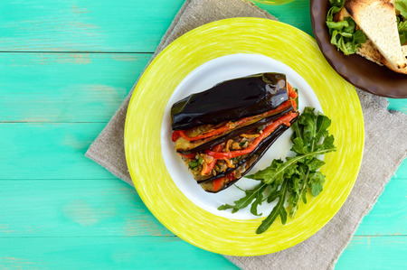 satisfying: Baked eggplant slices stuffed with vegetables. Satisfying vegan dish. The top view.