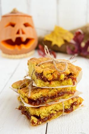 Freshly baked homemade cake with apricot jam. Dessert on Halloween.