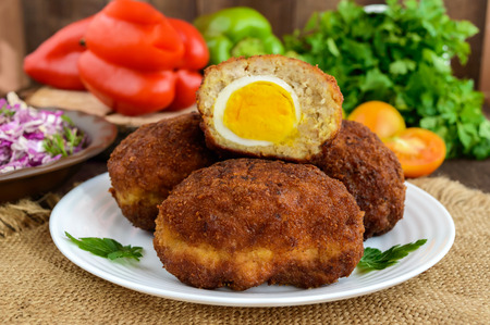 meatloaf: Meat mini-rolls (cutlet) with boiled egg. Close up