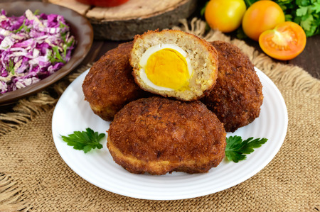 albondigas: Meat mini-rolls (cutlet) with boiled egg. Close up