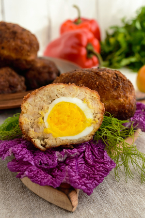 scottish culture: Meat mini-rolls (cutlet) with boiled egg. Close up