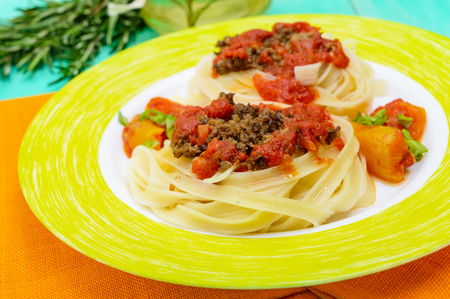 carbohydrates: Pasta nest tagliatelle with bolognese sauce on a plate. Stock Photo