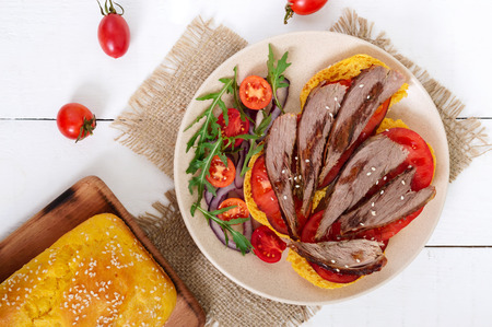 Useful sandwiches: goose breast on pumpkin bread, salad from tomatoes, arugula, red onions.