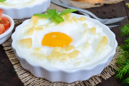Delicate baked egg Orsini (eggs in the cloud). French breakfast.