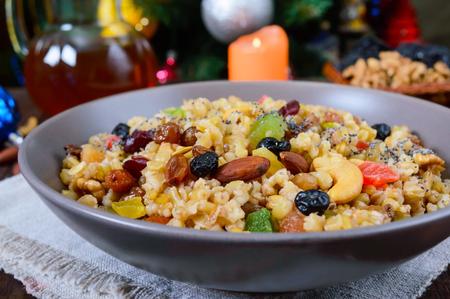 Wheat porridge with different nuts, dried berries, poppy seeds, raisins, honey. Kutya. Christmas dish of the Slavs.