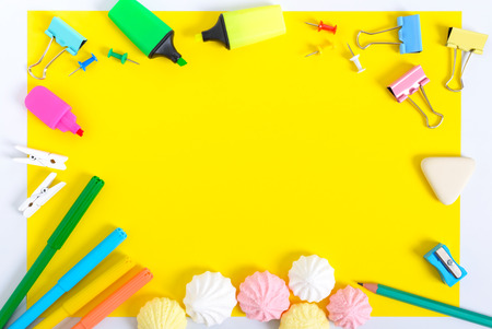 School accessories on a yellow background. Back to school concept. Office and student supplies. Free space for your project. The top view. Flat lay.