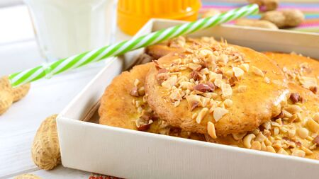 Shortbread dairy cookies with chopped nuts, milk and honey. Cookies in a box.  Close up Stockfoto