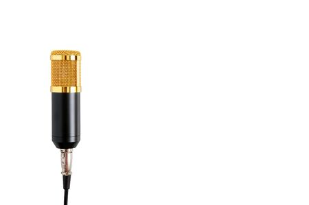 Gold microphone isolated on white background. Musical theme. Condenser microphone. Close up