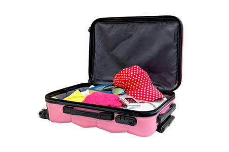 Open pink suitcase with things for the rest, isolated on white. Family travel bag packed to vacation. Luggage full of clothes, trip concept