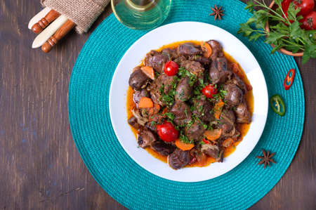 Roast turkey liver with vegetables and herbs. Diet dish. Top view Stock Photo