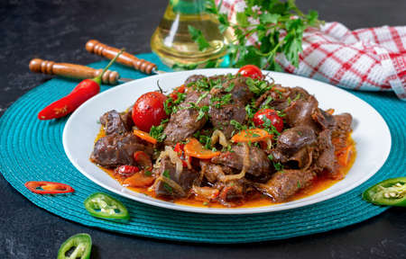 Roast turkey liver with vegetables and herbs. Diet dish Stock Photo