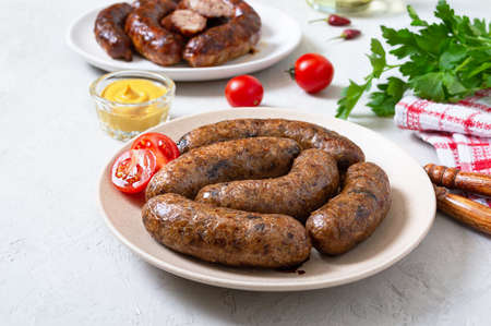 Meat sausages and alternative vegetarian buckwheat sausages.