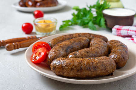 Homemade buckwheat sausages on a plate. Vegetarian menu. Stock Photo