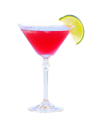 red cocktail with lime on white background. martini glass photo