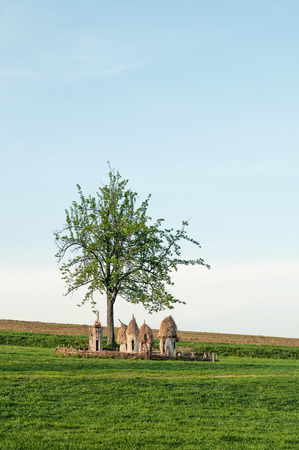 pirogovo: Ukrainian wooden hives in a field under a tree in Pirogovo near Kiev Stock Photo