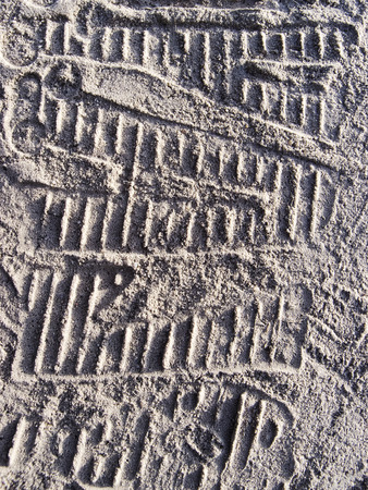 parallelism: texture of sand. footprints in the sand.