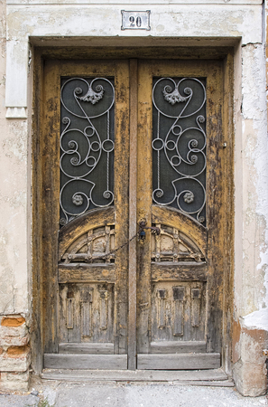 large doors: old large wooden doors with glass Stock Photo