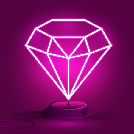 El diamante de neón rosa en el soporte brilla en la oscuridad.