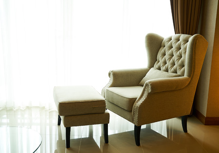 stool: Sofa and stool bright light from window