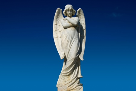 angel cemetery: Angel Statue crossing arms with trumpet  Stock Photo