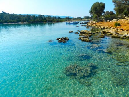 beach, coast and bay with crystal clear sea water. boat off the coast. turquoise lagoon