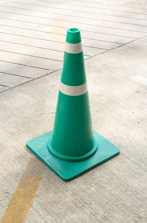 traffic cone: Green Traffic Cone On Street To Warning The Car