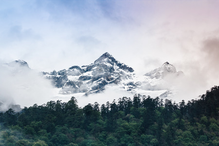 in mountain: Cloudy Sky Snow mountain with fog , Lachen North Sikkim India Stock Photo