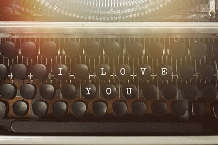 I love you text on a vintage typewriter text. Love letter concept.