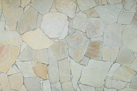 Uneven sandstone tiles wall texture background. Stock Photo
