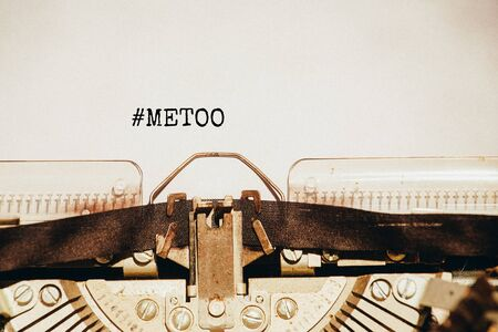 Metoo concept. Metoo hashtag coming out of typewriter.