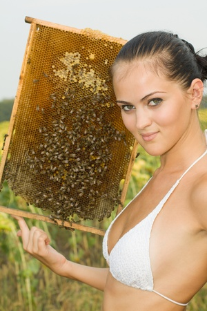 The girl on an apiary Stock Photo