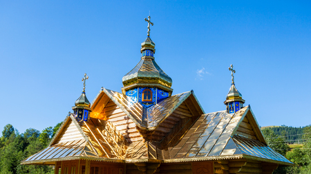 domes: Wooden Church with gold domes Stock Photo