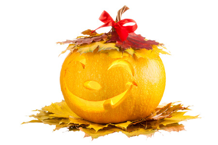 Pumpkin for Halloween with a smile in the leaves on a white background Stock Photo