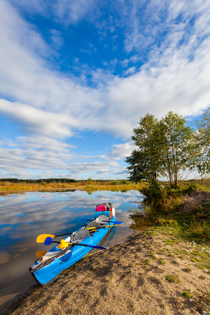 riverside trees: Water tourism on the river by canoe in the summer, relax by the river
